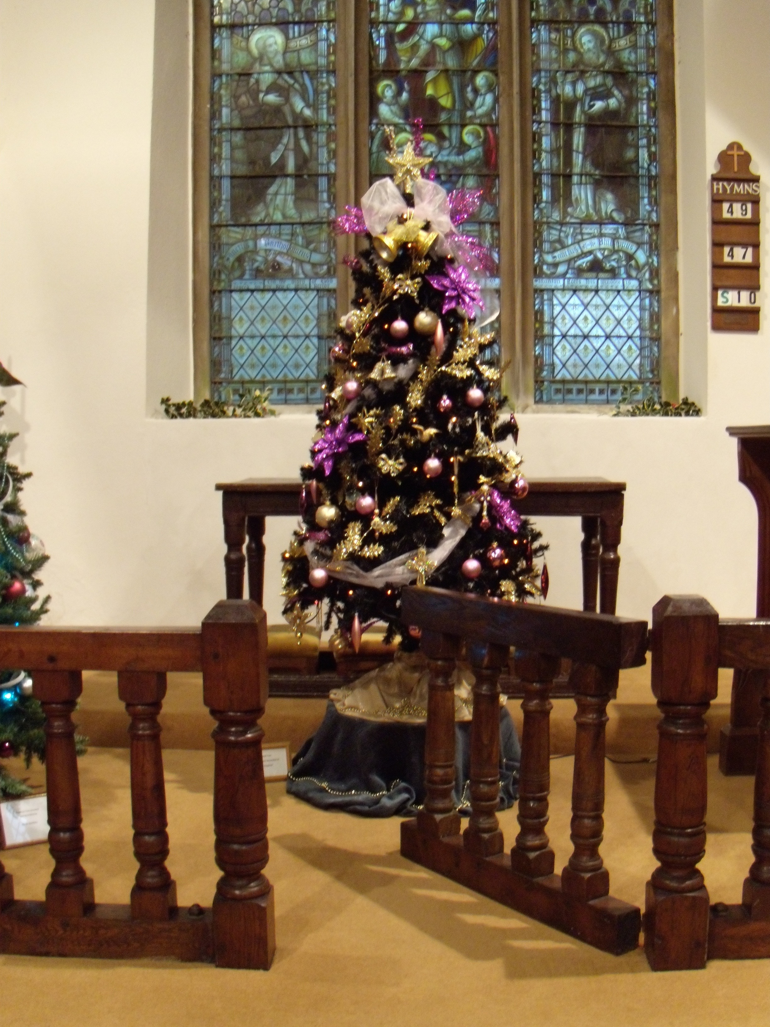 Christmas tree in front of altar