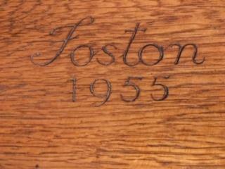 "Close up of bookcase inscribed ""Foston 1955"""